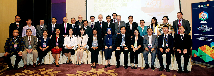 At the partners' forum, Dr. Gil C. Saguiguit, Jr. (standing, sixth from left), SEARCA Director, joined His Excellency Ivo Sieber (standing, tenth from left), Ambassador of Switzerland to Thailand; Atty. Roberto V. Oliva (standing, seventh from left), ACB Executive Director; Dr. Berthold Seibert (standing, sixth from right), project director of the ACB-GIZ Biodiversity and Climate Change Project (BCCP); ASEAN senior officials; as well as representatives of donor agencies, NGOs, development organizations, and the private sector. [br] (Photo courtesy of Francis Dejon/ACB)